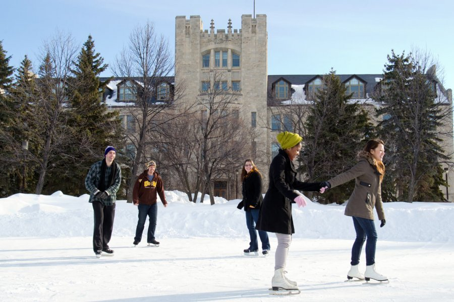 A group of International University of Manitoba students try outdoor ice skating on campus.