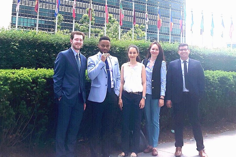 Five University of Manitoba students outside the United Nations