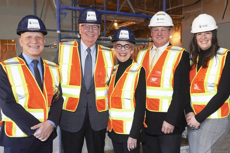 Doctors Arni Thorsteinson and Susan Glass at centre posing for a photo wearing construction gear