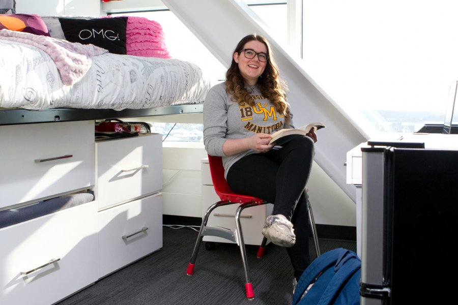 A University of Manitoba student sits in her Pembina Hall Residence room studying.