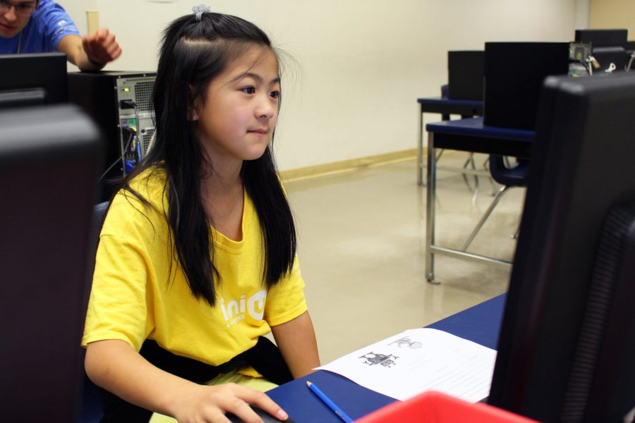 A Mini U junior coding in a computer lab.