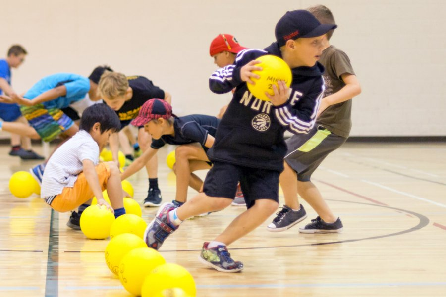 Players rush to grab the dodgeballs during a dodgeball game.
