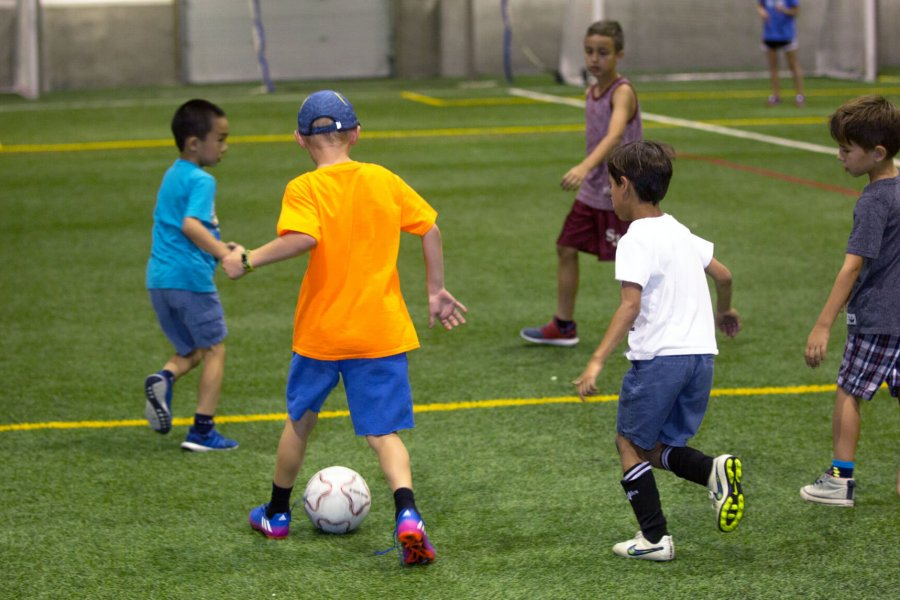 Opposing teams playing a game of soccer.