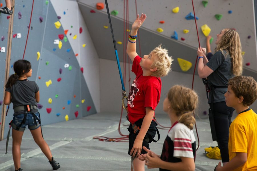 Participants observe others on the climbing wall.