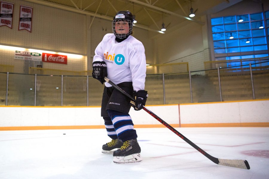 A young hockey player gets set to receive a pass.