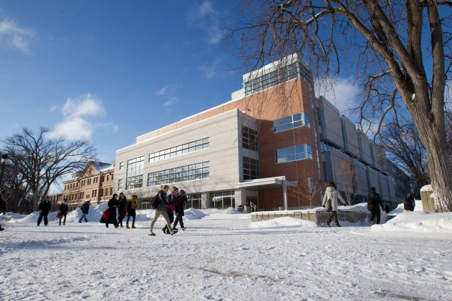 Students walk on campus in winter.