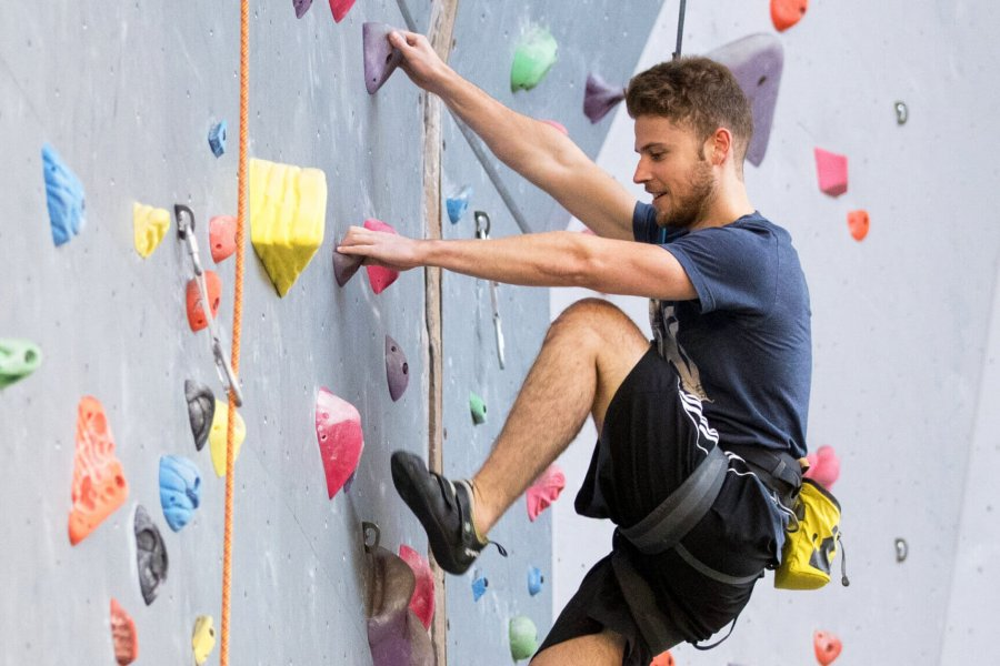 A man expertly scales the Active Living Centre climbing wall.