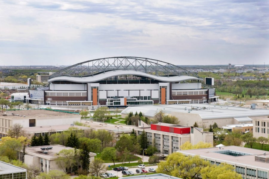 An aerial view of the University of Manitoba that shows several buildings and Investors Group Field.