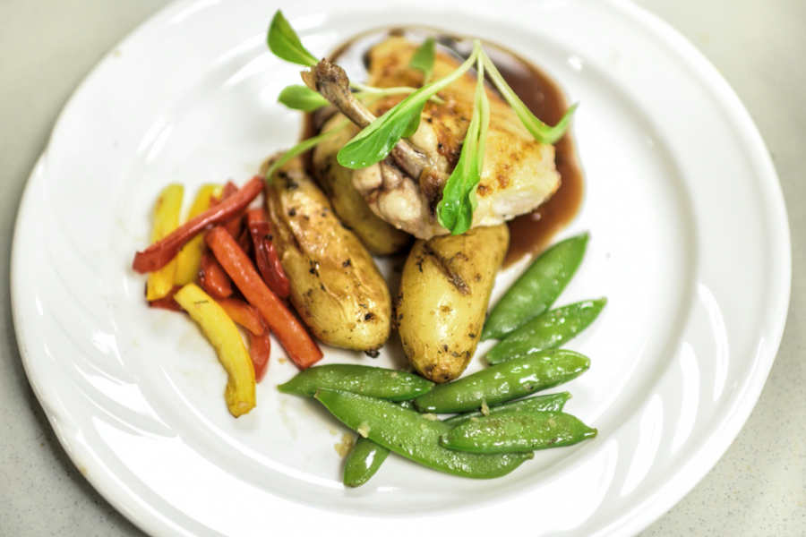 Elegant plated dinner of chicken, potatoes, and vegetables