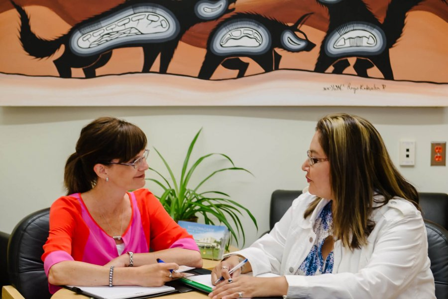 An Indigenous student works with an advisor to plan her first year.