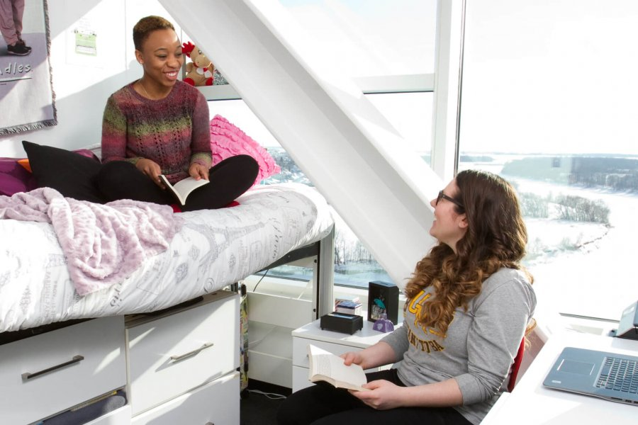 Two students sit together in a Pembina Hall student residence on the Fort Garry campus.