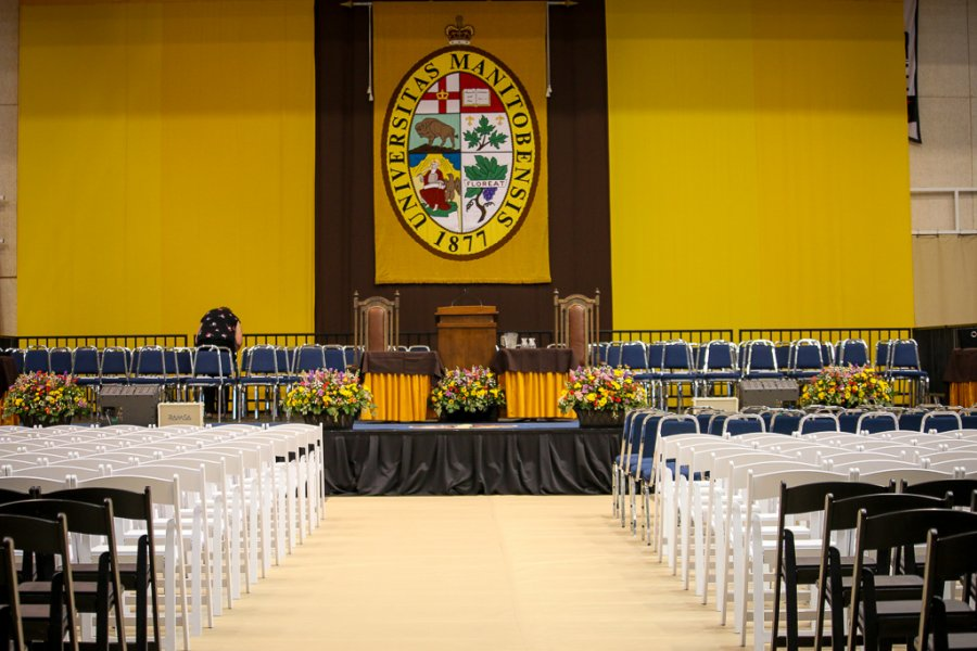 An empty room at convocation, with all seats unfilled.