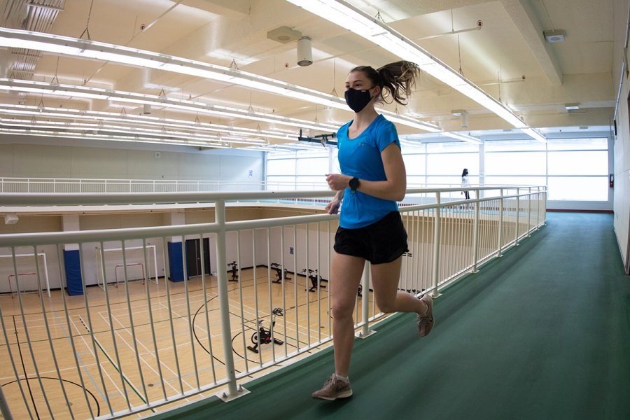 member running on track at Joe Doupe Recreation Centre