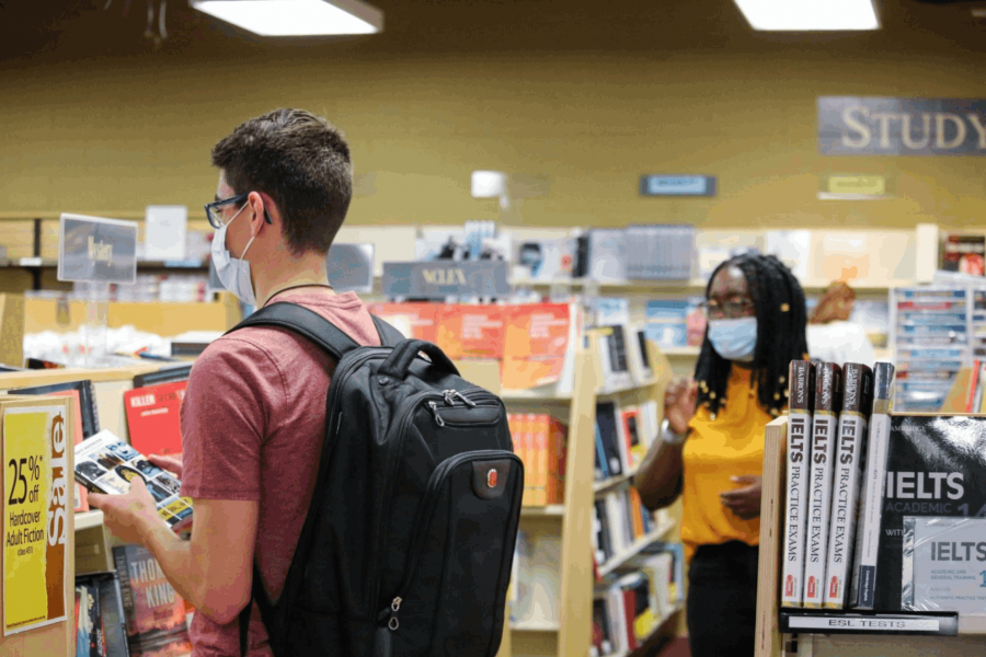 Students wearing personal protective masks in the Bookstore.