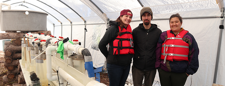 U of M students visiting the pickerel hatchery on an island in the Churchill River