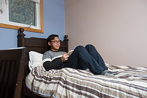 A Homestay student rests in a bedroom
