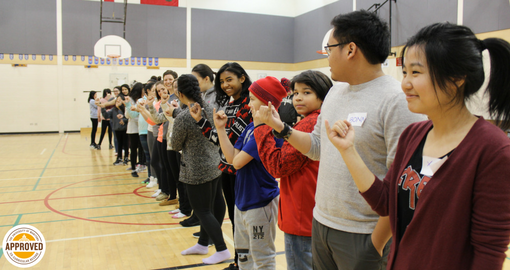 U of M mentors playing an icebreaker game with Skownan youth