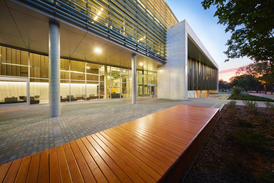 A beautifully illuminated front entrance of the Active Living Centre during a sunset.