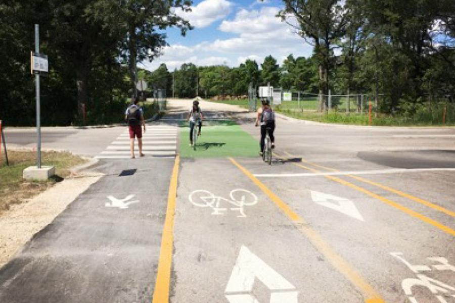 UM students using a pedestrian and cycling lane at the Fort Garry campus